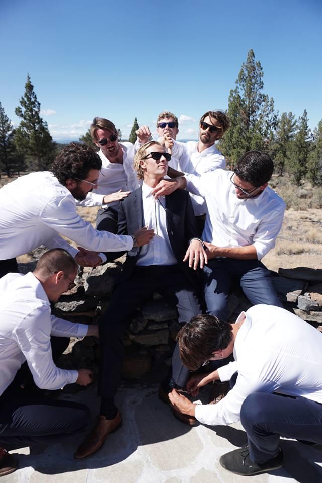 Groomsmen prep the groom