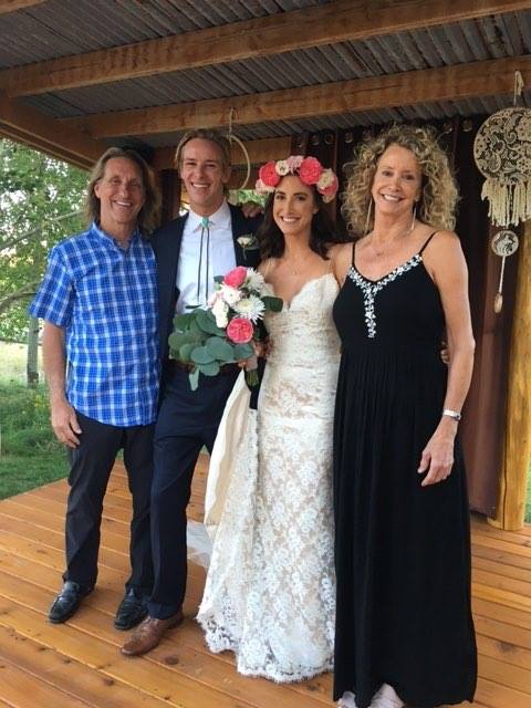 Wedding photo of bride groom and parents of bride