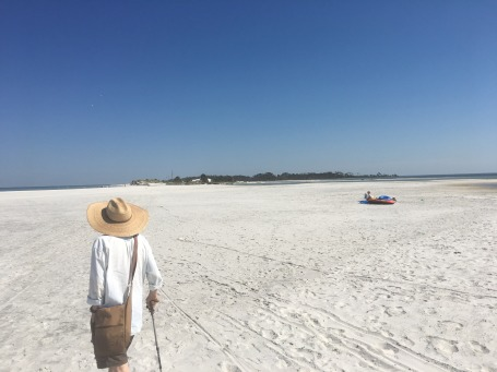 John's photo of Randy walking on the state park beach.jpg